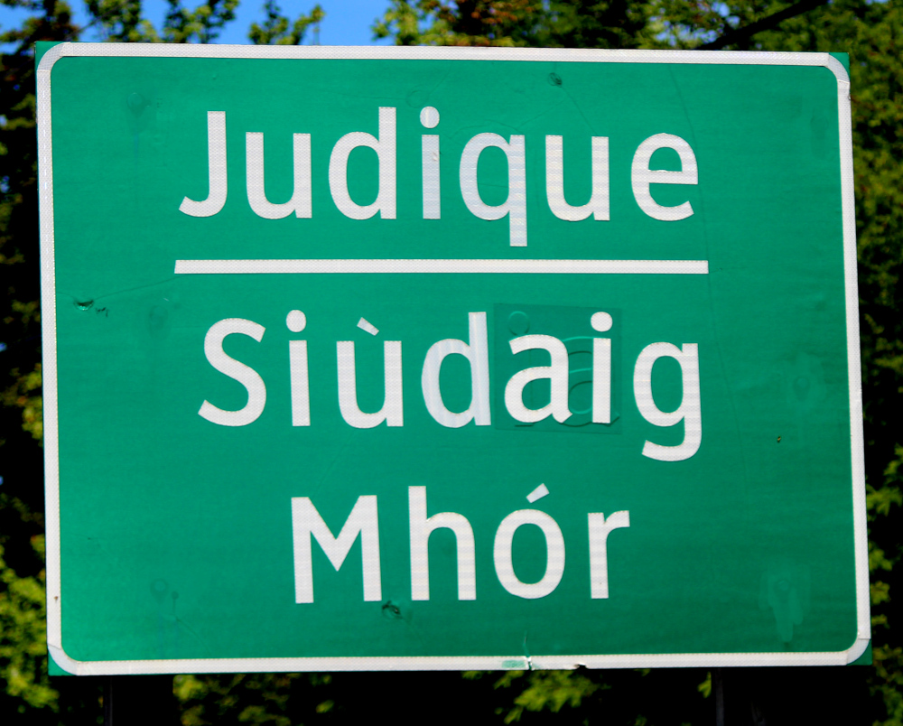 This is Judique along the Ceilidh Trail on the west coast of Cape Breton.  All community names are in English & Gaelic along the Ceilidh Trail.