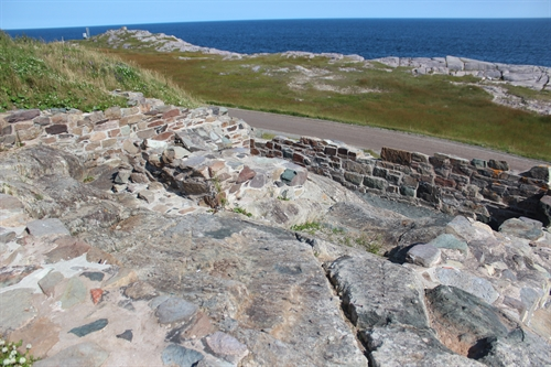 These are ruins from the 1st (1734) and 2nd (1842) lighthouses at Louisbourg.  These ruins are located at the base of the current lighthouse.