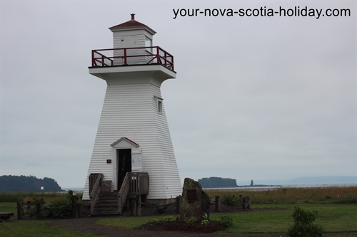 A wonderful 'pepper pot' lighthouse on the shores of the Bay of Fundy in Five Islands, Nova Scotia.  Note the islands in the background.