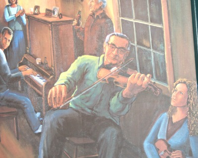 A painting of Buddy MacMaster, a young Natalie MacMaster and the late John Morris Rankin of the Rankin Family