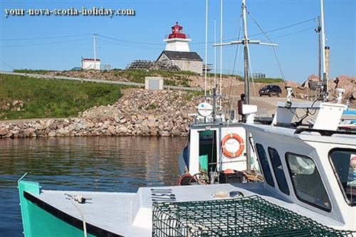 Neil's Harbour in northern Cape Breton.  A delightful fishing village complete with a lighthouse and seafood shack on the cliffs overlooking the Atlantic ocean.