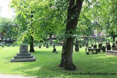 View of the Old Burying Ground filled with old tombstones and old trees.